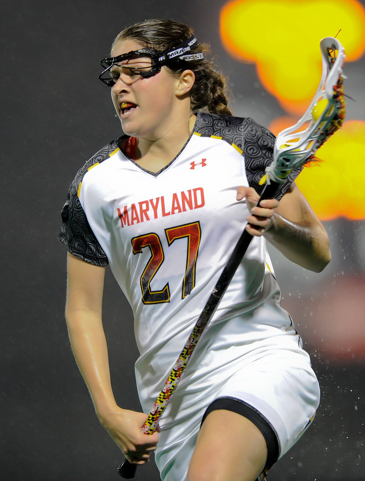 MAR 2, 2012 : Maryland defender Shanna Brady (27) with the ball during action between the Virginia Cavaliers and the University of Maryland Womens Lacrosse match up at the Field Hockey and Lacrosse Complex at the University of Maryland in College Park, MD. The Terrapins defeated the Cavaliers 12-9.