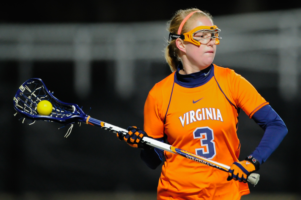 MAR 2, 2012 : Virginia Attacker Josie Owen (3) handles the ball behind the Maryland net during action between the Virginia Cavaliers and the University of Maryland Womens Lacrosse match up at the Field Hockey and Lacrosse Complex at the University of Maryland in College Park, MD. The Terrapins defeated the Cavaliers 12-9.