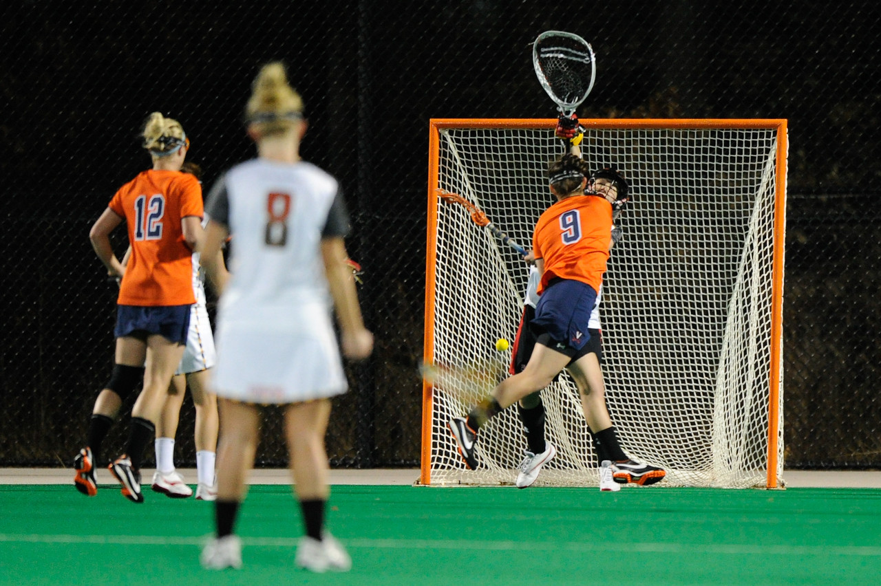 MAR 2, 2012 : Virginia's Liza Blue (9) shoots and scores a goal during action between the Virginia Cavaliers and the University of Maryland Womens Lacrosse match up at the Field Hockey and Lacrosse Complex at the University of Maryland in College Park, MD. The Terrapins defeated the Cavaliers 12-9.
