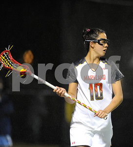 MAR 2, 2012 : Maryland's Alex Aust (10) during action between the Virginia Cavaliers and the University of Maryland Womens Lacrosse match up at the Field Hockey and Lacrosse Complex at the University of Maryland in College Park, MD. The Terrapins defeated the Cavaliers 12-9.
