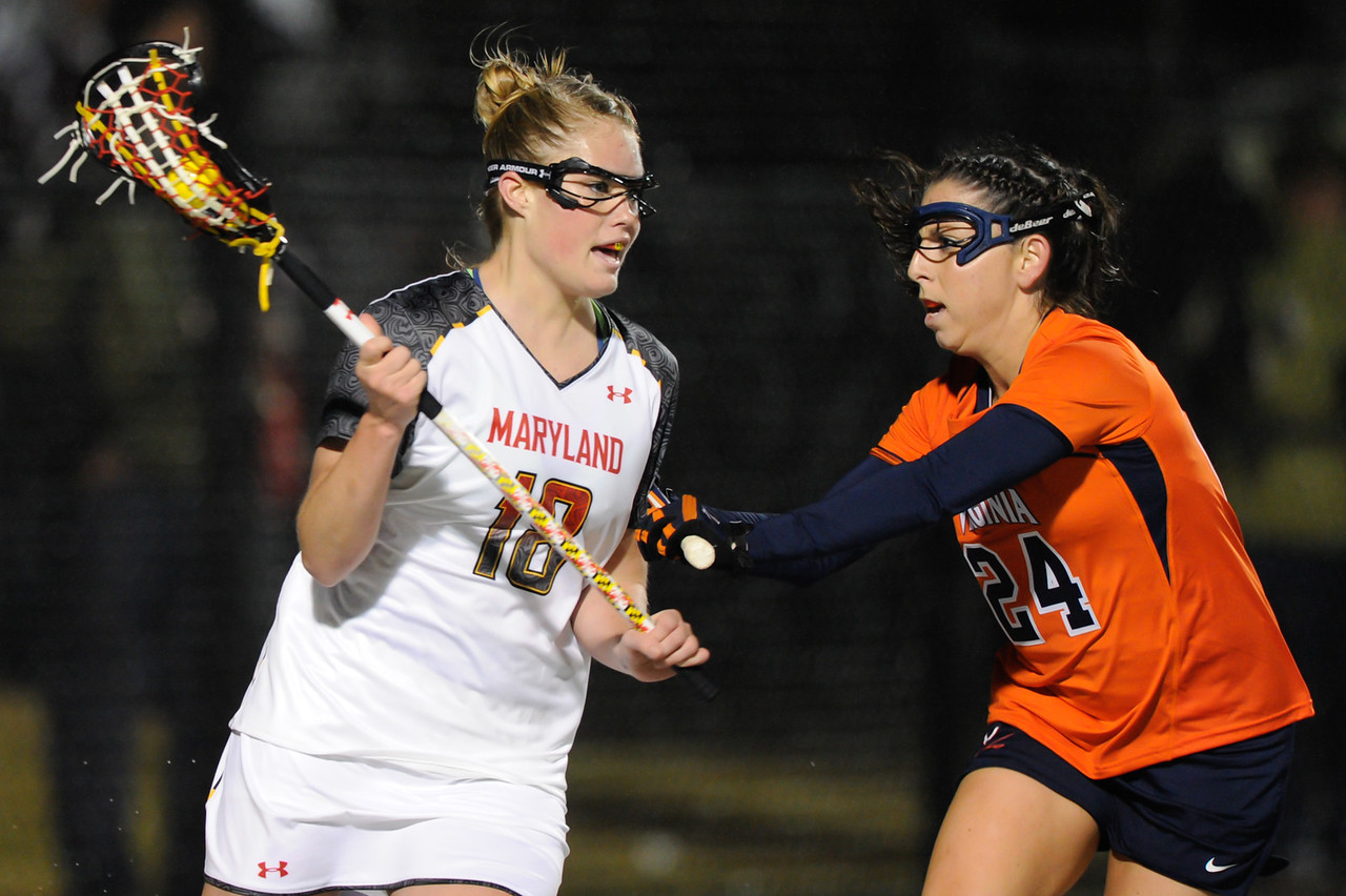 MAR 2, 2012 : Maryland Attacker Karri Ellen Johnson (18) battles Virginia's Julie Gardner (24) during action between the Virginia Cavaliers and the University of Maryland Womens Lacrosse match up at the Field Hockey and Lacrosse Complex at the University of Maryland in College Park, MD. The Terrapins defeated the Cavaliers 12-9.