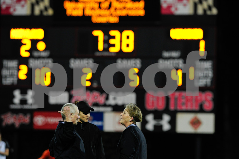 MAR 2, 2012 : The game officials discuss a goal that Virginia scored after their player came onto the field too soon from a penalty during action between the Virginia Cavaliers and the University of Maryland Womens Lacrosse match up at the Field Hockey and Lacrosse Complex at the University of Maryland in College Park, MD. The Terrapins defeated the Cavaliers 12-9.
