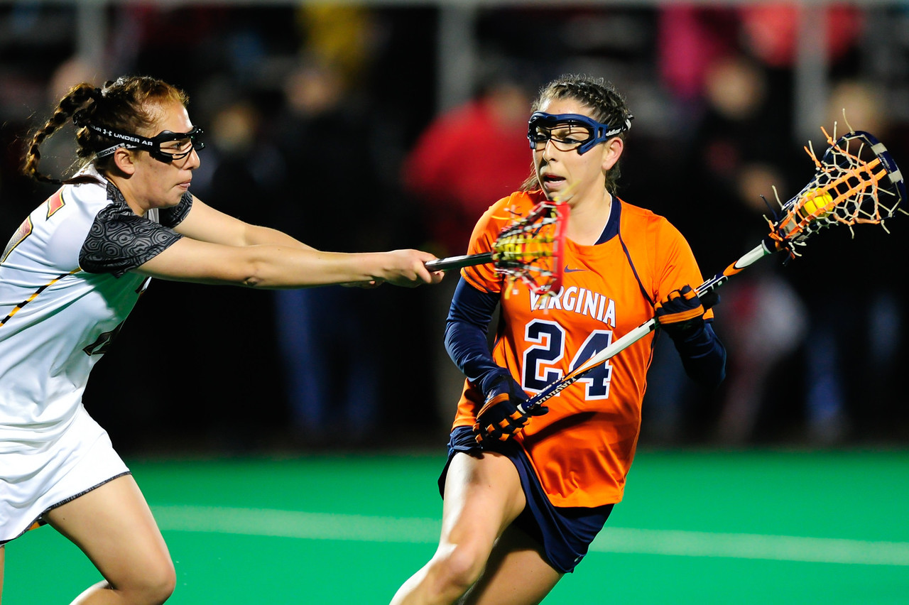 MAR 2, 2012 : Maryland Defender Melissa Diepold (15) battles Virginia's Julie Gardner (24) during action between the Virginia Cavaliers and the University of Maryland Womens Lacrosse match up at the Field Hockey and Lacrosse Complex at the University of Maryland in College Park, MD. The Terrapins defeated the Cavaliers 12-9.