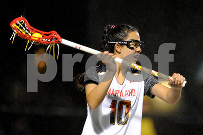 MAR 2, 2012 : Maryland Attacker Alex Aust (10) with the ball during action between the Virginia Cavaliers and the University of Maryland Womens Lacrosse match up at the Field Hockey and Lacrosse Complex at the University of Maryland in College Park, MD. The Terrapins defeated the Cavaliers 12-9.