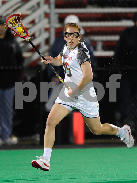 MAR 2, 2012 : Maryland Defender Melissa Diepold (15) controls the ball during action between the Virginia Cavaliers and the University of Maryland Womens Lacrosse match up at the Field Hockey and Lacrosse Complex at the University of Maryland in College Park, MD. The Terrapins defeated the Cavaliers 12-9.