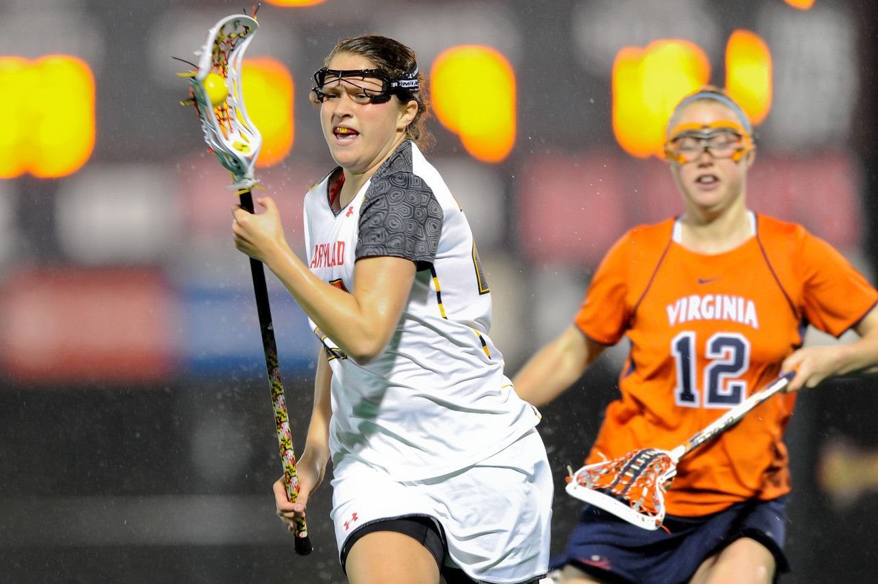 MAR 2, 2012 : Maryland's Shanna Brady (27) advances the ball during action between the Virginia Cavaliers and the University of Maryland Womens Lacrosse match up at the Field Hockey and Lacrosse Complex at the University of Maryland in College Park, MD. The Terrapins defeated the Cavaliers 12-9.