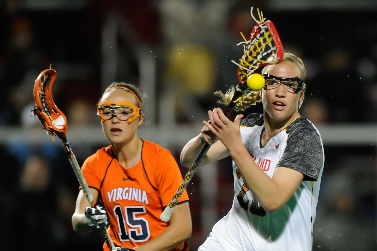 MAR 2, 2012 : Maryland Midfielder Beth Glaros (20) tries to get control of the ball during action between the Virginia Cavaliers and the University of Maryland Womens Lacrosse match up at the Field Hockey and Lacrosse Complex at the University of Maryland in College Park, MD. The Terrapins defeated the Cavaliers 12-9.