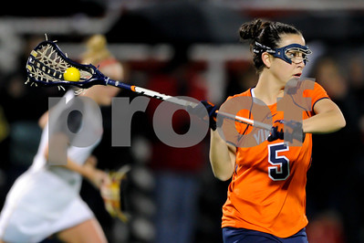 MAR 2, 2012 : Virginia's Megan Dunleavy (5) passes the ball during action between the Virginia Cavaliers and the University of Maryland Womens Lacrosse match up at the Field Hockey and Lacrosse Complex at the University of Maryland in College Park, MD. The Terrapins defeated the Cavaliers 12-9.