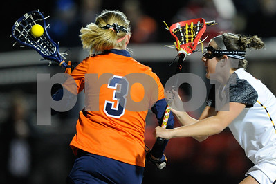MAR 2, 2012 : Virginia Attacker Josie Owen (3) battles Maryland's Katie Schwarzmann (7) during action between the Virginia Cavaliers and the University of Maryland Womens Lacrosse match up at the Field Hockey and Lacrosse Complex at the University of Maryland in College Park, MD. The Terrapins defeated the Cavaliers 12-9.