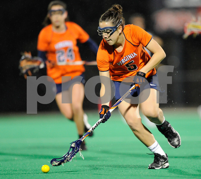 MAR 2, 2012 : Virginia's Megan Dunleavy (5) scoops up the ball during action between the Virginia Cavaliers and the University of Maryland Womens Lacrosse match up at the Field Hockey and Lacrosse Complex at the University of Maryland in College Park, MD. The Terrapins defeated the Cavaliers 12-9.