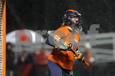 MAR 2, 2012 : Virginia's Goalie Kim Kolarik (30) yells to teammates during action between the Virginia Cavaliers and the University of Maryland Womens Lacrosse match up at the Field Hockey and Lacrosse Complex at the University of Maryland in College Park, MD. The Terrapins defeated the Cavaliers 12-9.