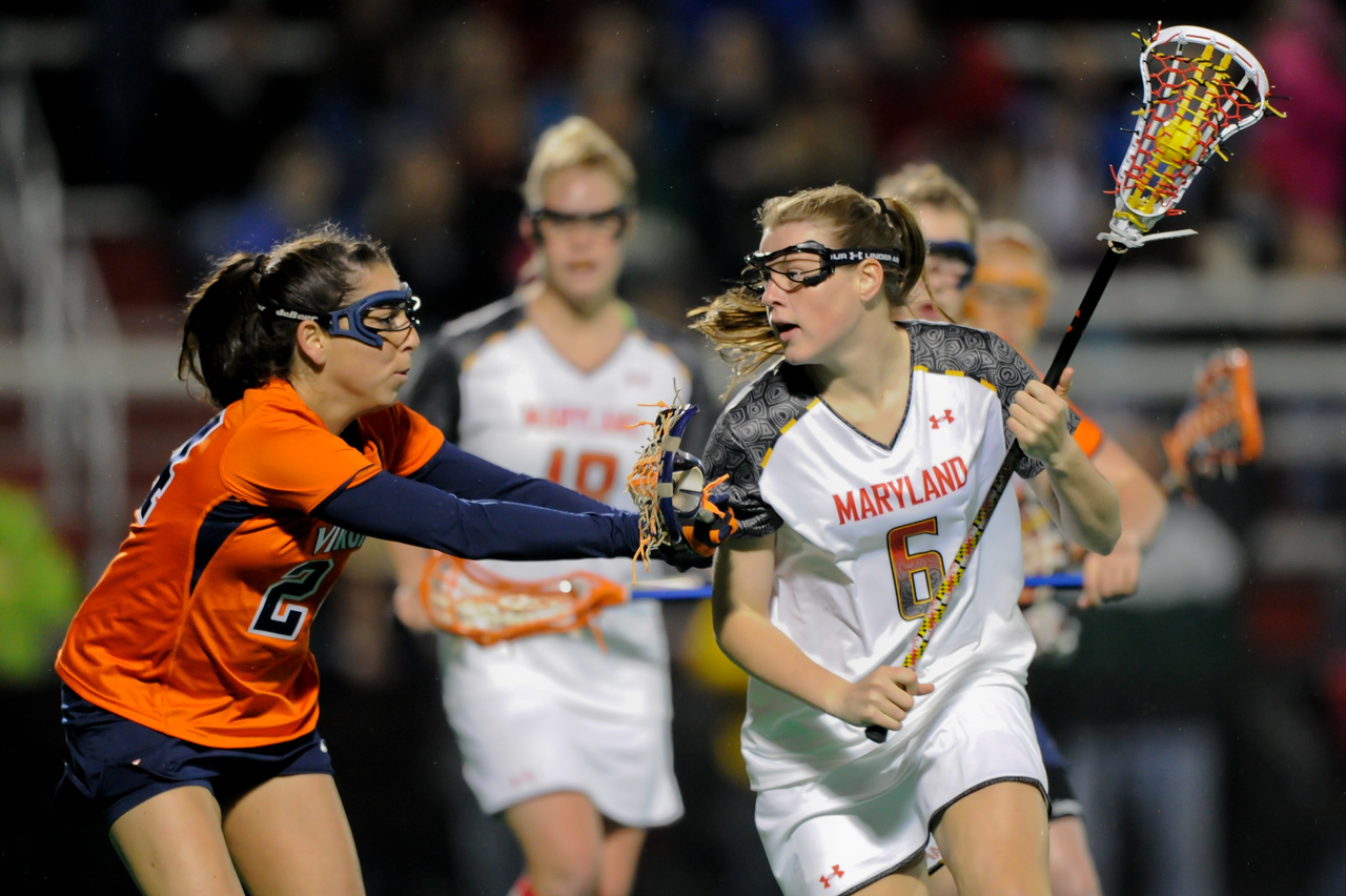 MAR 2, 2012 : Maryland Midfielder Kelly McPartland (6) battles Virginia's Julie Gardner (24) during action between the Virginia Cavaliers and the University of Maryland Womens Lacrosse match up at the Field Hockey and Lacrosse Complex at the University of Maryland in College Park, MD. The Terrapins defeated the Cavaliers 12-9.