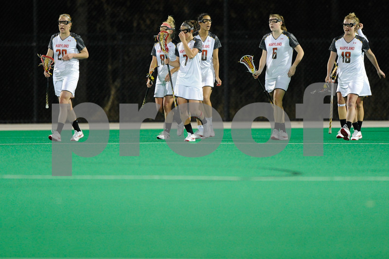 MAR 2, 2012 : The Maryland players walk back to midfield after scoring a goal during action between the Virginia Cavaliers and the University of Maryland Womens Lacrosse match up at the Field Hockey and Lacrosse Complex at the University of Maryland in College Park, MD. The Terrapins defeated the Cavaliers 12-9.
