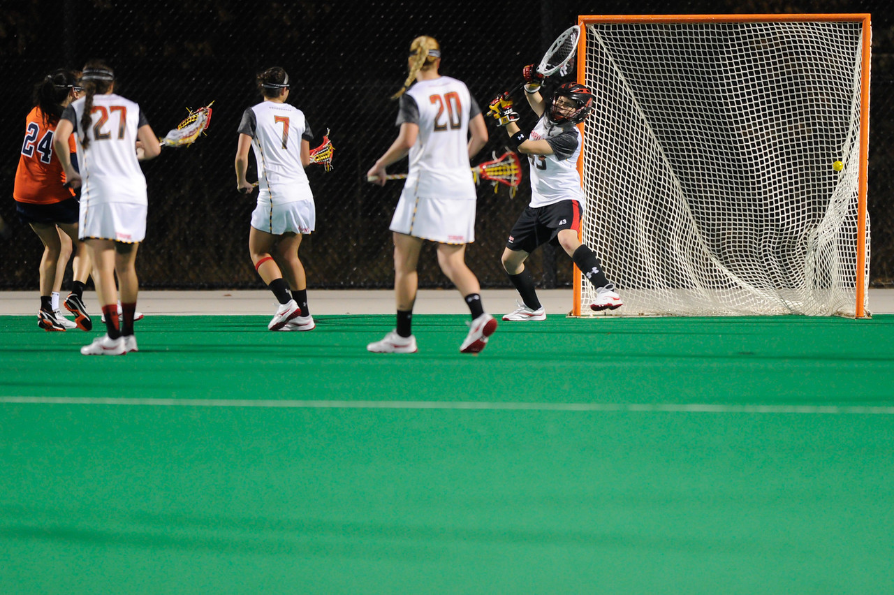 MAR 2, 2012 : Virginia's Julie Gardner (24) scores a goal past Maryland Goalie Brittany Dipper (43) during action between the Virginia Cavaliers and the University of Maryland Womens Lacrosse match up at the Field Hockey and Lacrosse Complex at the University of Maryland in College Park, MD. The Terrapins defeated the Cavaliers 12-9.
