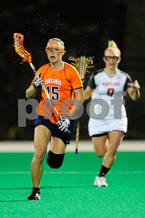MAR 2, 2012 : Virginia Midfielder Kelsey Gahan (15) advances the ball down the field during action between the Virginia Cavaliers and the University of Maryland Womens Lacrosse match up at the Field Hockey and Lacrosse Complex at the University of Maryland in College Park, MD. The Terrapins defeated the Cavaliers 12-9.