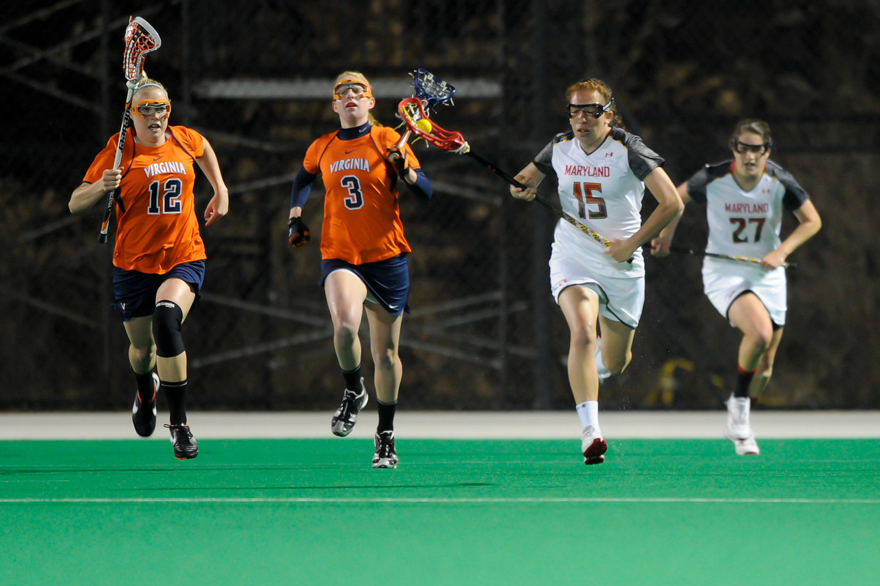 MAR 2, 2012 : Maryland's Melissa Diepold (5) breaks away with the ball during action between the Virginia Cavaliers and the University of Maryland Womens Lacrosse match up at the Field Hockey and Lacrosse Complex at the University of Maryland in College Park, MD. The Terrapins defeated the Cavaliers 12-9.