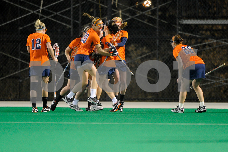 MAR 2, 2012 : The Virginia Cavalier team celebrates after scoring a goal during action between the Virginia Cavaliers and the University of Maryland Womens Lacrosse match up at the Field Hockey and Lacrosse Complex at the University of Maryland in College Park, MD. The Terrapins defeated the Cavaliers 12-9.