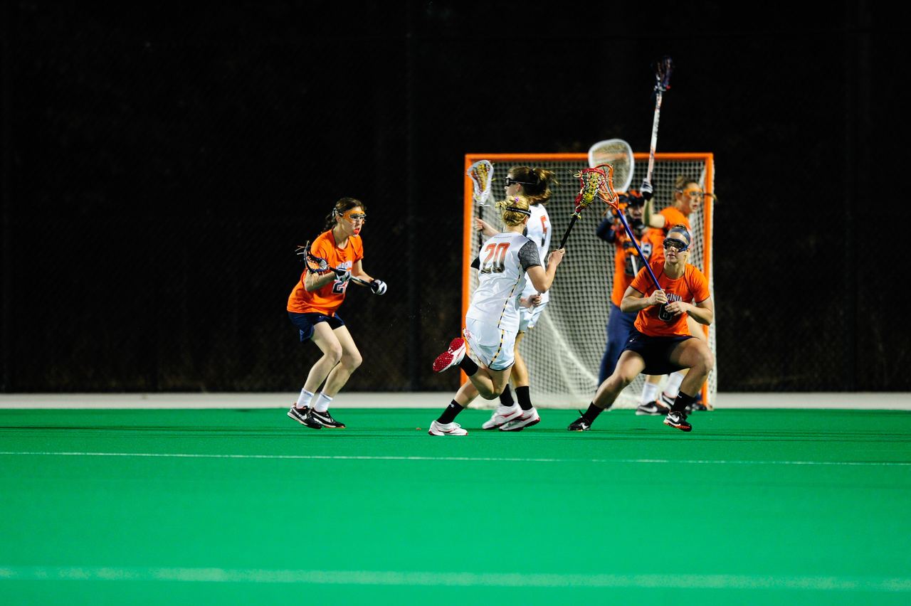 MAR 2, 2012 : Maryland's Midfielder Beth Glaros (20) handles the ball in front of the Virginia net during action between the Virginia Cavaliers and the University of Maryland Womens Lacrosse match up at the Field Hockey and Lacrosse Complex at the University of Maryland in College Park, MD. The Terrapins defeated the Cavaliers 12-9.