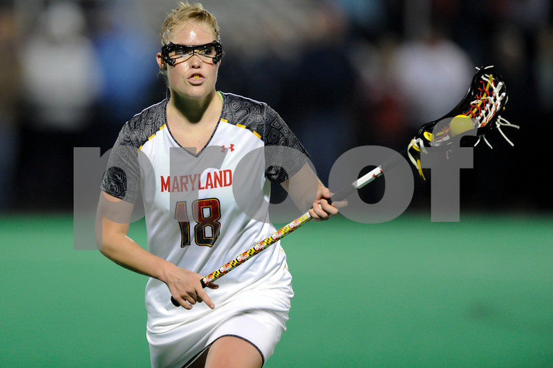 MAR 2, 2012 : Maryland Attacker Karri Ellen Johnson (18) advances the ball during action between the Virginia Cavaliers and the University of Maryland Womens Lacrosse match up at the Field Hockey and Lacrosse Complex at the University of Maryland in College Park, MD. The Terrapins defeated the Cavaliers 12-9.