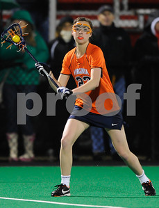 MAR 2, 2012 : Virginia's Lelan Bailey (23) passes the ball during action between the Virginia Cavaliers and the University of Maryland Womens Lacrosse match up at the Field Hockey and Lacrosse Complex at the University of Maryland in College Park, MD. The Terrapins defeated the Cavaliers 12-9.