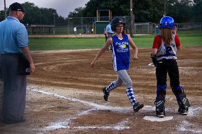 Hannah comes across the plate in the second inning to add to the Bombers' lead