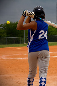 Jasmine hits a ball up the middle
