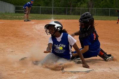 Azia crushes the catcher to lodge the ball out... SAFE!