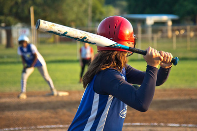 Sarah loads up for the pitch as Azia waits on second base