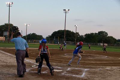 Sarah slaps the ball to the shortstop and Azia advances to third base