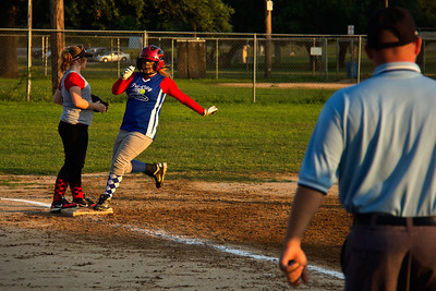 Addie pulls into third base after a lead-off triple