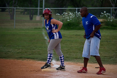 Coach Bryant gets in Addie's ear at first base... get ready to run!