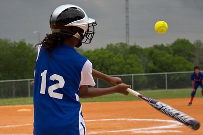 Azia smacks the ball