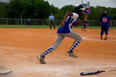 Azia tries to outrun the shortstop's arm
