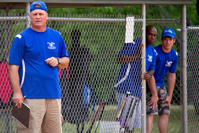 Coach Tony watches the play while Coaches Bryant and Chris peak around the corner