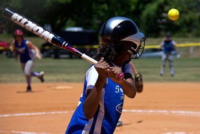 Azia measures up the pitch before hitting an inside-the-park homerun