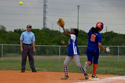 Azia goes for the ball at first base