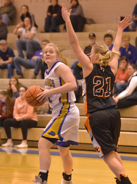 Justin Sheely   The Sheridan Press<br /> Sheridan's Katie Tomlinson, left, looks controls the ball against Natrona County High School's Marquel Gibson at Sheridan High School Saturday, Jan. 13, 2018. The Lady Broncs won 47-43.