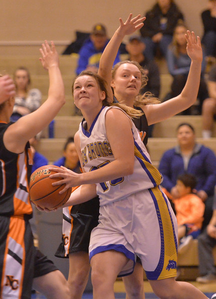 Justin Sheely   The Sheridan Press<br /> Sheridan's Kailee Ingalls goes for two against Natrona County's Kylie Hilderbrand at Sheridan High School Saturday, Jan. 13, 2018. The Lady Broncs won 47-43.