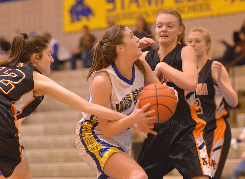 Justin Sheely   The Sheridan Press<br /> Sheridan's Bailey Coon goes for a layup against Natrona County High School at Sheridan High School Saturday, Jan. 13, 2018. The Lady Broncs won 47-43.