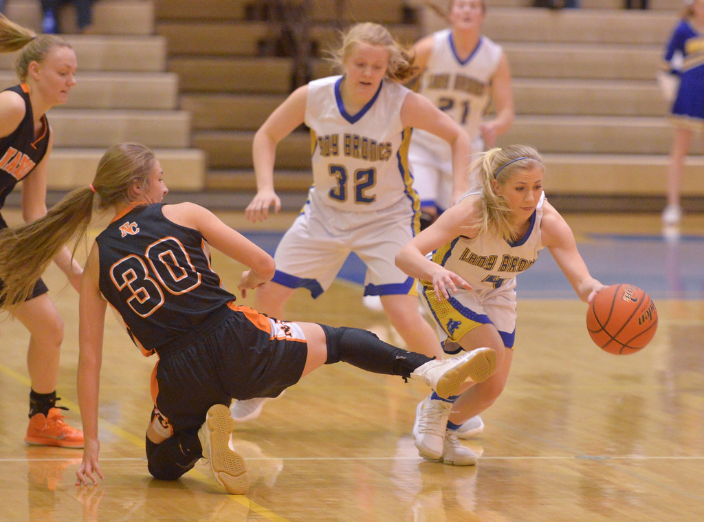 Justin Sheely | The Sheridan Press<br /> Sheridan's Kaylee Abernatha, right, steals the ball from Natrona County High School's Kristy Dick at Sheridan High School Saturday, Jan. 13, 2018. The Lady Broncs won 47-43.