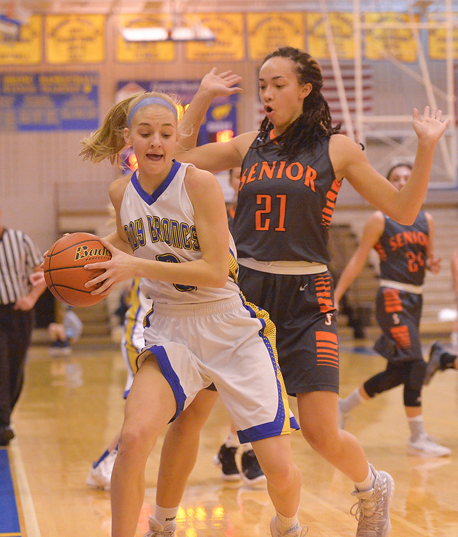 Justin Sheely | The Sheridan Press<br /> Sheridan's Katie Ligocki is pushed out by Senior's Bailey Eleazer during the Lady Broncs' home opener at Sheridan High School Friday, Dec. 15, 2017. The Lady Broncs lost to Billings Senior 64-59.