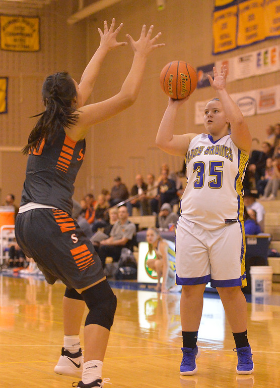 Justin Sheely | The Sheridan Press<br /> Sheridan's Zoie Jones shoots for three over Senior's Kola Bad Bear during the Lady Broncs' home opener at Sheridan High School Friday, Dec. 15, 2017. The Lady Broncs lost to Billings Senior 64-59.
