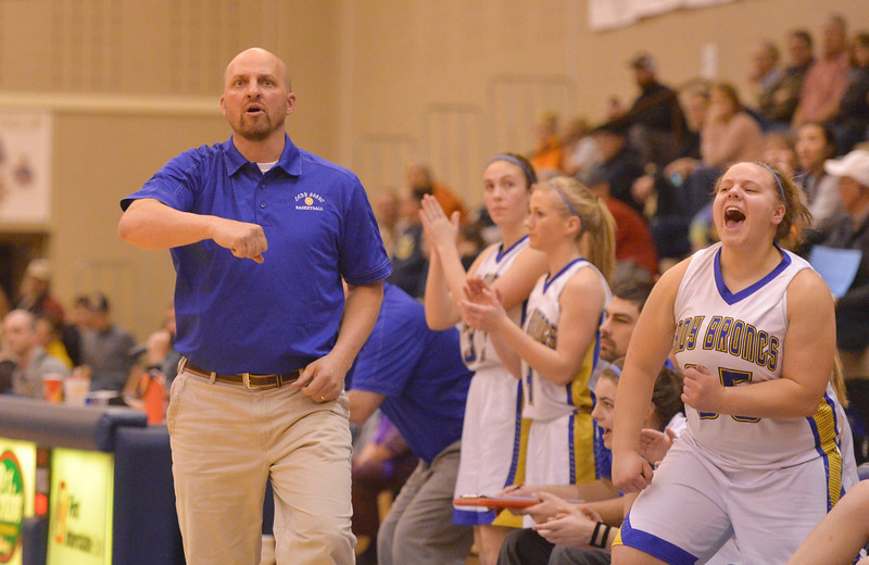 Justin Sheely | The Sheridan Press<br /> Sheridan's girls basketball head coach Larry Ligocki reacts after the Lady Broncs make a point late in the four quarter against Senior High School during their home opener at Sheridan High School Friday, Dec. 15, 2017. The Lady Broncs lost to Billings Senior 64-59.