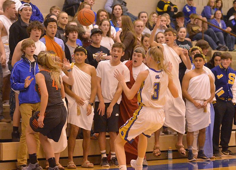 Justin Sheely | The Sheridan Press<br /> Fans in the student section react as the ball goes out during the Lady Broncs' home opener at Sheridan High School Friday, Dec. 15, 2017. The Lady Broncs lost to Billings Senior 64-59.