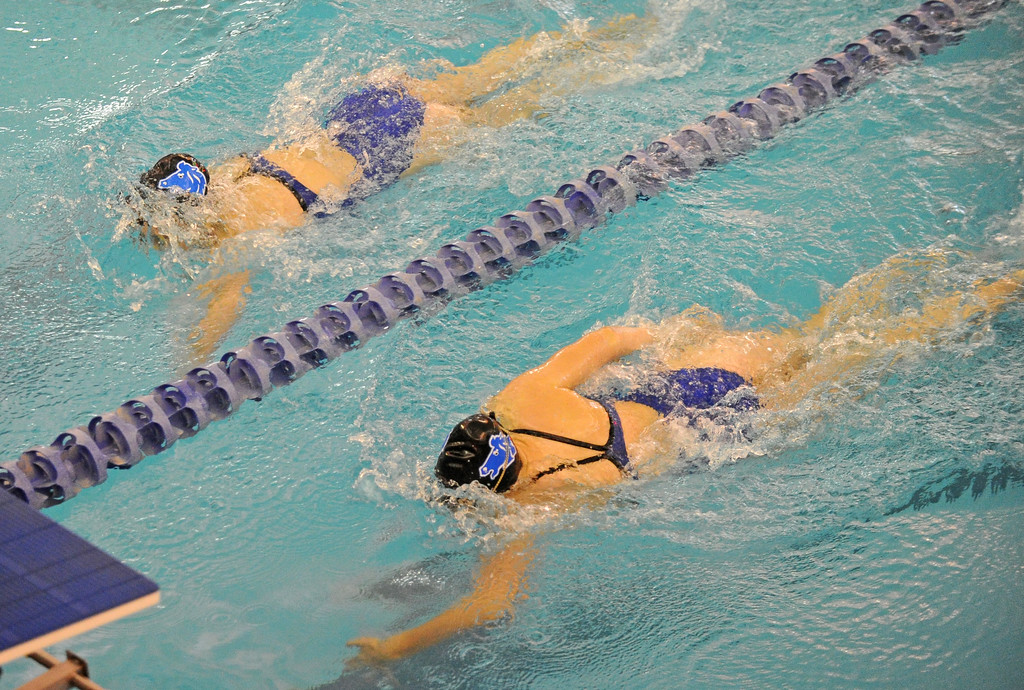 Jadyn Mullikin, left, and Piper Carroll swim neck and neck in the 100-meter backstroke during the Sheridan Invite on Saturday, Sept. 23 at Sheridan Junior High School. Mike Pruden | The Sheridan Press