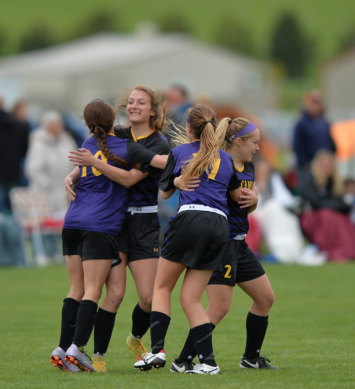 Justin Sheely | The Sheridan Press<br /> Campbell County girls, from left, Grace Roswadovski, Baylee Hamlin, Kennedy Ayers and Delaney Hallcroft celebrate their first goal against Cheyenne Central during the girls class 4a State Championship semifinals game Friday at the Big Horn Equestrian Center. The Lady Camels won 2-0.