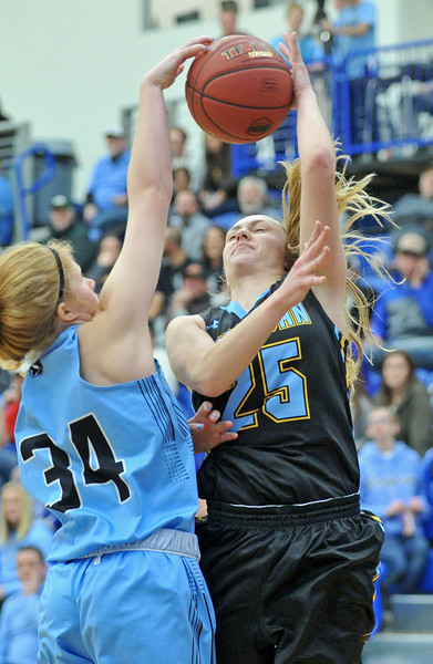 Mike Pruden | The Sheridan Press<br /> Sheridan College's Raelynn Keefer, right, gets blocked but draws a foul on Gillette College's Haley Urbatsch at the Pronghorn Center in Gillette Wednesday, Jan. 24, 2018.