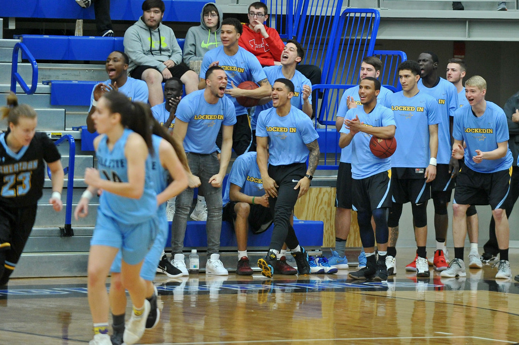 The Sheridan College men's basketball team celebrates from the sideline during the women's game at the Pronghorn Center in Gillette Wednesday, Jan 24, 2018.