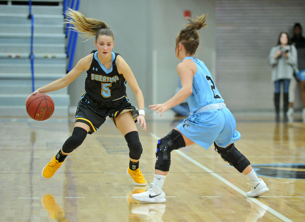 Mike Pruden | The Sheridan Press<br /> Lily Jex (5) crosses over in front of Gillette College's Rickie Engesser at the Pronghorn Center in Gillette Wednesday, Jan 24, 2018.