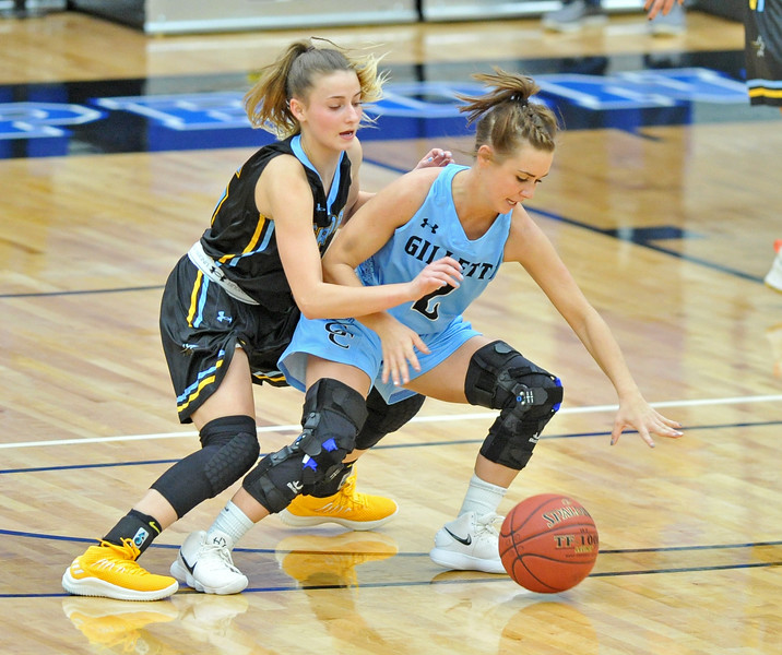Mike Pruden | The Sheridan Press<br /> Sheridan College's Lily Jex, left, guards Gillette College's Rickie Engesser at the Pronghorn Center in Gillette Wednesday, Jan. 24, 2018.